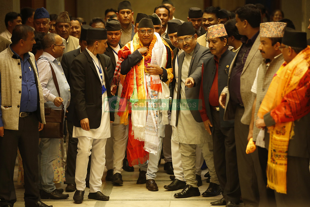 June 6, 2017 - Kathmandu, Nepal - Newly elect Prime Minister Sher Bahadur Deuba waves after being elected for the fourth time as the 40th Prime Minister of Nepal at the Legislature-Parliament in Kathmandu, Nepal on June 6, 2017. (Credit Image: © Skanda Gautam via ZUMA Wire)