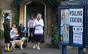 UNITED KINGDOM, London: 7 May 2015,  Helpers are photographed outside a a polling station in Barnes to help the general public to cast there vote for the 2015 Election, London, England. Andrew Cowie / Story Picture Agency