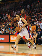 Dec. 10 2010; Phoenix, AZ, USA; Phoenix Suns guard Steve Nash (13) drives the ball past Portland Trailblazers  forward Marcus Camby (23) during the second half at the US Airways Center.  The Trailblazers defeated the Suns 101-94. Mandatory Credit: Jennifer Stewart-US PRESSWIRE.