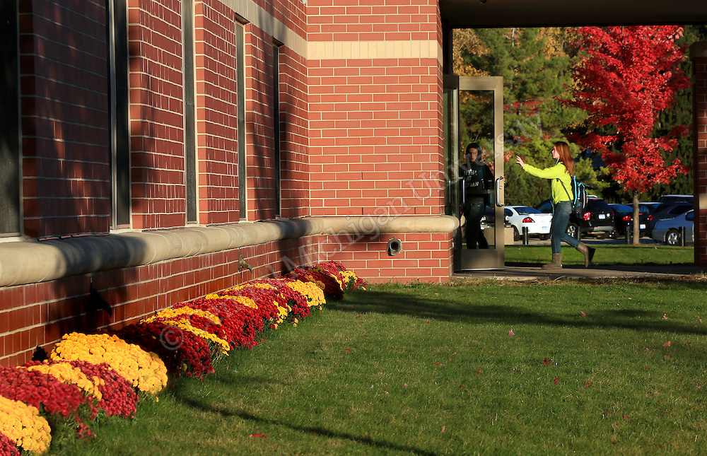 Sunrise and mums at Kesseler Hall at the Towers. Fall color features scenics at Central Michigan University. Central Michigan University photo by Steve Jessmore