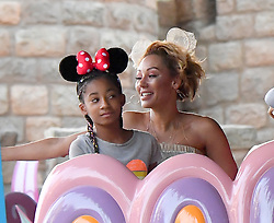 Mel B celebrates her daughter Madison's birthday at Disneyland. Mel was all smiles as she spent time with her kids and friends, posing with characters and eating hot dogs. They were seen riding the small world ride and Alice in Wonderland. they posed with Mickey and Minnie and Goofy. Mel B purchased and drank out of an Olaf cup. 04 Sep 2017 Pictured: Mel B, Madison Belafonte, Angel Brown. Photo credit: Snorlax / MEGA TheMegaAgency.com +1 888 505 6342