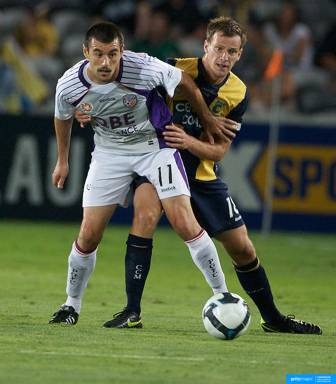 Branko Jelic, (left) and Alex Wilkinson in action during the Central Coast Mariners V Perth Glory A-League match at Gosford, New South Wales, Australia, on Friday, November 27, 2009. Photo Tim Clayton.