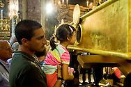 Roma 6 Luglio 2013<br /> Iniziano le celebrazioni in onore  di San Camillo de Lellis per il IV Centenario dalla sua morte ,con l'inaugurazione dell'urna monumentale per le sacre spoglie di San Camillo , nella Chiesa di Santa Maria Maddalena a Roma. I fedeli rendono omaggio alle spoglie di San Camillo<br /> Rome July 6, 2013<br /> They start the celebrations in honor of St. Camillus de Lellis for the Fourth Centenary of his death, with the inauguration of the urn monumental for the sacred remains of St. Camillus, in the Church of Santa Maria Maddalena in Rome.Pictured  The of  faithful homage to the remains of St. Camillus