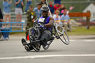 July 4th, 2006:  Anchorage, Alaska - James McGilberry (554), Army veteran from Banning, Calif, enters the first corner of the 5k handcycle event at the 26th National Veterans Wheelchair Games a little too fast, raising his left rear wheel losing control, and heading towards the safety fence.