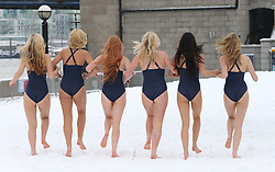 Models run in the snow at a pop up beach near Tower Bridge in London to cheer up commuters on ' Blue Monday' , reportedly the most depressing day of the year, Monday 21st  January 2013. Photo by: Stephen Lock / i-Images