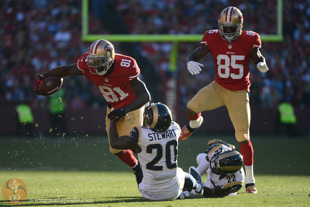 December 1, 2013; San Francisco, CA, USA; San Francisco 49ers wide receiver Anquan Boldin (81) is tackled by St. Louis Rams strong safety Darian Stewart (20) during the third quarter at Candlestick Park. The 49ers defeated the Rams 23-13.