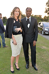 HANNAH GRIFFITH and ROUBI L'ROUBI at the Chovgan Twilight Polo Gala in association with the PNN Group held at Ham Polo Club, Petersham Close, Richmond, Surrey on 10th September 2014.