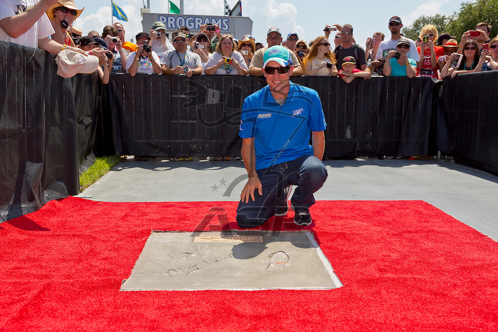 DAYTONA BEACH, FL - JUL 07, 2012:  Matt Kenseth (17) signs autographs and poses for photos as his footprints are unveiled at the Daytona Walk of Fame before the start of the Coke Zero 400 at the Daytona International Speedway in Daytona Beach, FL.