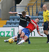 Wigan's Ryan Jennings clatters Dundee's Calvin Colquhoun - Dundee v Wigan Athletic - pre season friendly at Dens Park<br /> <br />  - &copy; David Young - www.davidyoungphoto.co.uk - email: davidyoungphoto@gmail.com