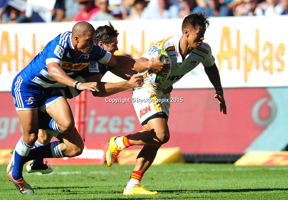 Tim Nanai-Williams of the Chiefs pulls away from Juan de Jongh and Kobus van Wyk of the Stormers during the 2015 Super Rugby game between the Stormers and the Chiefs at Newlands Stadium, Cape Town on 14 March 2015 ©Ryan Wilkisky/BackpagePix