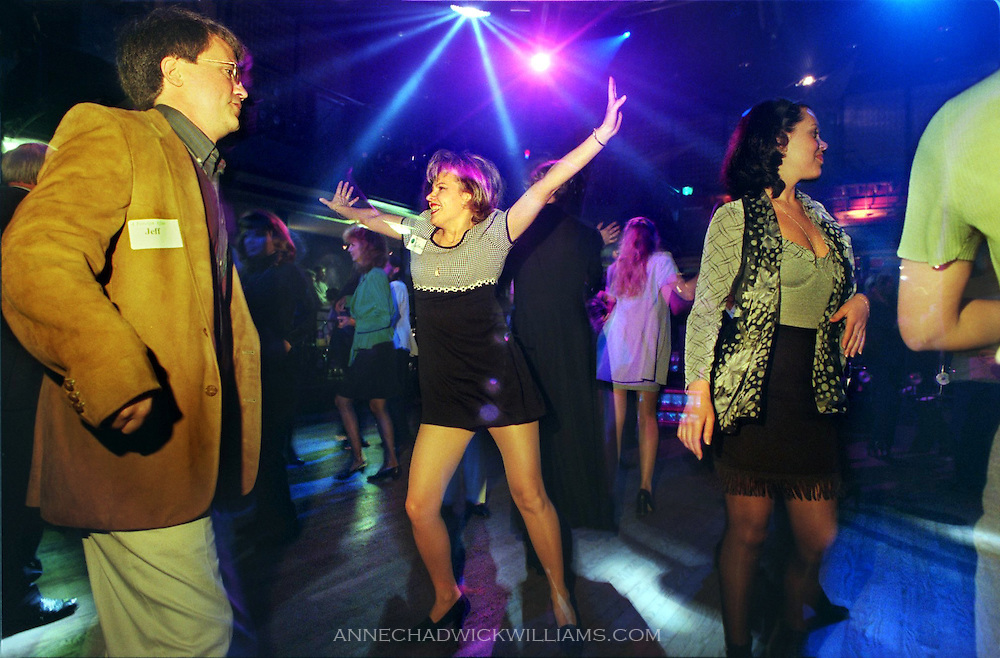 An American man, left, dances in St. Petersburg, Russia with a potential Russian bride while in town searching for a wife.
