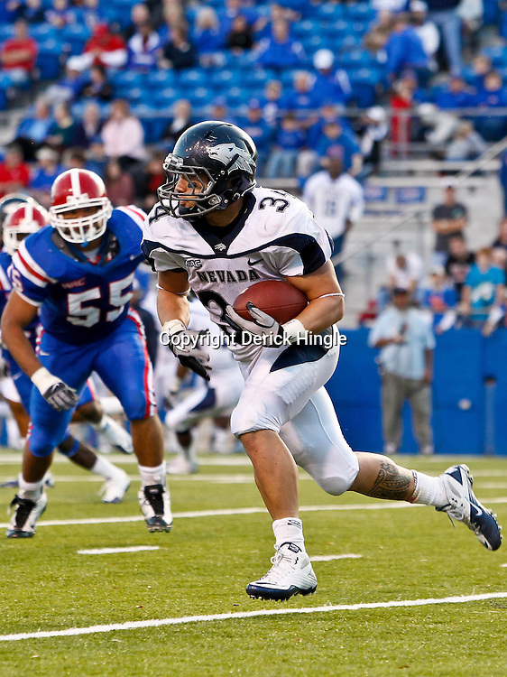 December 4, 2010; Ruston, LA, USA; Nevada Wolf Pack running back Vai Taua (34) against the Louisiana Tech Bulldogs during the second half at Joe Aillet Stadium.  Nevada defeated Louisiana Tech 35-17. Mandatory Credit: Derick E. Hingle