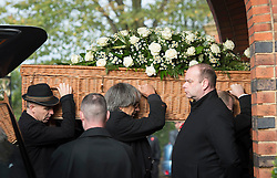 © London News Pictures. 05/11/2014. The coffin entering the church.. The funeral Jack Bruce at Golders Green Crematorium in North London. Jack Bruce was the lead singer and bass player for British Rock band Creme, alongside Eric Clapton and Ginger Baker. Creme sold over 15 million albums worldwide and were widely considered to be the worlds first successful supergroup. Photo credit : Ben Cawthra/LNP