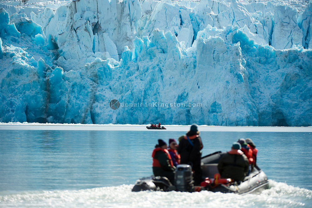 Guests of the National Geographic Sea Bird exploring the icy waters near the Dawes Glacier, Endicott Arm, Alaska in a DIB.