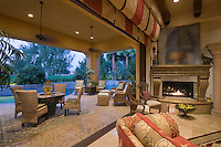 Open plan Palm Springs sitting room with lit fire