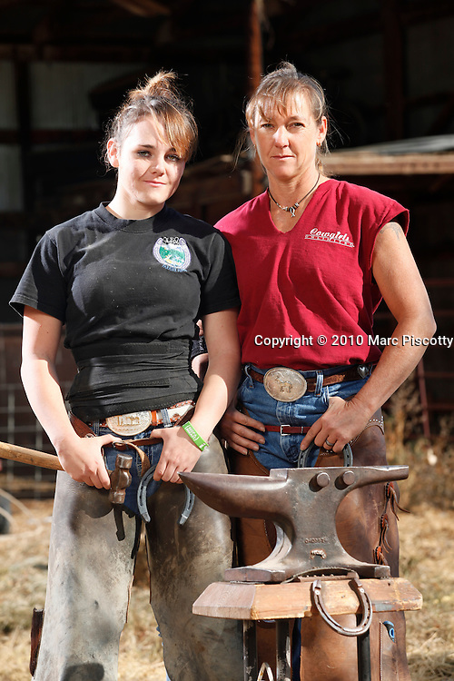 "SHOT 10/11/10 10:17:09 AM - Mother and daughter ferriers ""Eli"" (short for Elizabeth) and Rachel Hoyt, 14, of Diamond E Horseshoeing in La Salle, Co. ""Eli"" has been shoeing horses for more than 20 years and has brought her daughter in to help out during the summertime but Rachel isn't so sure that becoming a full-time ferrier is in her future. She said she's interested in studying forensic science in college. Elizabeth goes by ""Eli"" because the profession is still very male dominated. (Photo by Marc Piscotty / © 2010)"