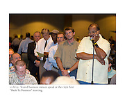 "10/6/05:  Scared business owners speak at the city's first ""Back To Business"" meeting after Katrina."