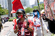 Red Shirts militants in front of the army which deployed this monday 19 april at Silom, the financial area of Bangkok where Reds have started to build a barricade.