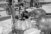 At Wood Street and 26th Street, Mona Choyce heads to fill her water containers at a local park during a hot day on Thursday, June 15, 2017, in Oakland, Calif. Many of the dozens of people living there were scrambling to find shade and avoid dehydration.