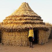 1985 Sudan Darfur. Neimat outside the hut (toukel) where she lives.