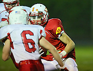 Marion's Quinn Cannoy (11) eyes Maquoketa's Alex Becker (6) after a reception during the first half of the game between Maquoketa and Marion at Thomas Park Field in Marion on Friday, September 21, 2012.
