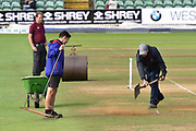 Groundstaff spreading sand to try and dry a damp patch after a heavy rain shower delayed the start of play during the Specsavers County Champ Div 1 match between Somerset County Cricket Club and Essex County Cricket Club at the Cooper Associates County Ground, Taunton, United Kingdom on 26 September 2019.