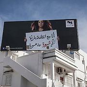 Tunisi, Henda blogger, la sua immagine in un affissione per una campagna di sensibilizzazizone sulle donne uscita l'8 marzo in diverse città della tunisia.