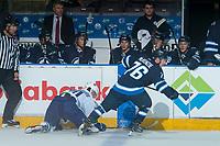PENTICTON, CANADA - SEPTEMBER 8: Skyler McKenzie #76 of Winnipeg Jets checks Matt Brassard #70 of Vancouver Canucks into the boards on September 8, 2017 at the South Okanagan Event Centre in Penticton, British Columbia, Canada.  (Photo by Marissa Baecker/Shoot the Breeze)  *** Local Caption ***