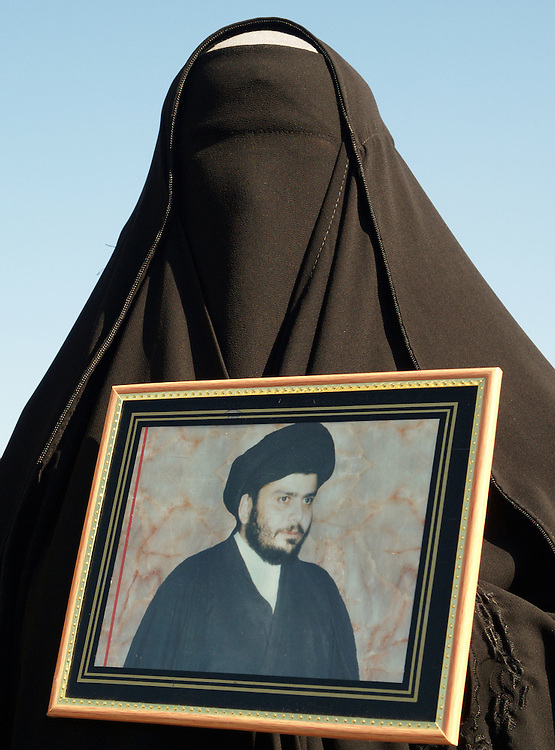 20th Jan 2004.Baghdad, Iraq.Iraqis protest on the streets of central Baghdad, many are carring posters of the firebrand cleric Moqtada al-Sadr.