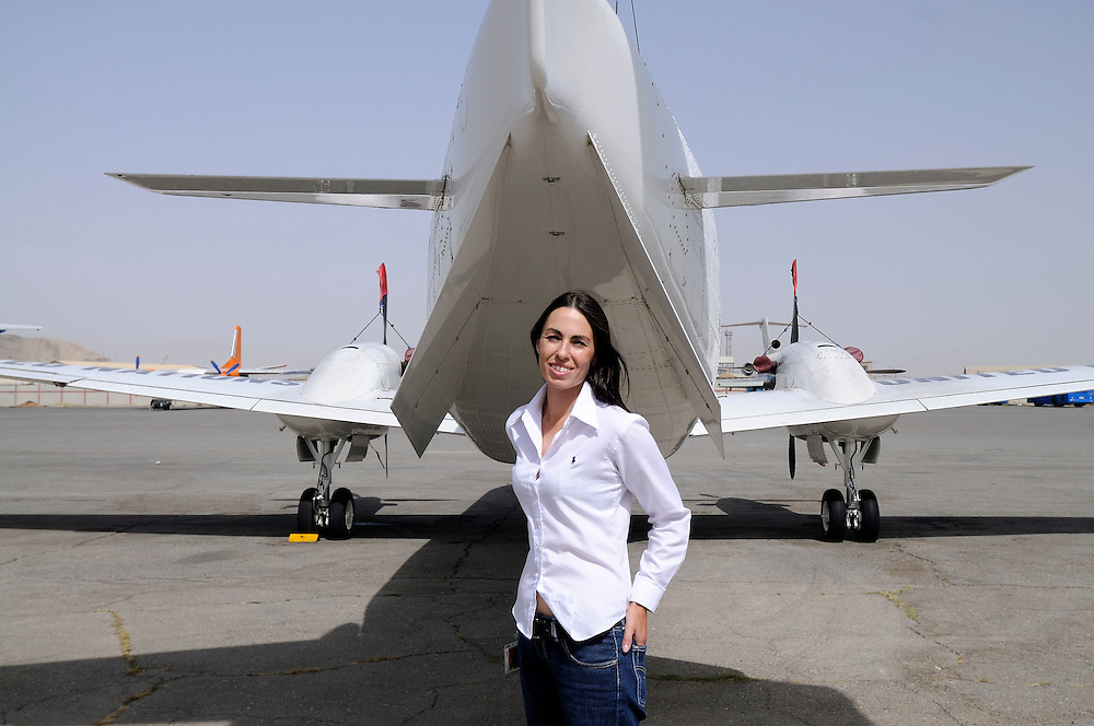 "Pilot, Danielle Aitchison, with the Beechcraft 1900D she flies in Afghanistan for The United Nations Humanitarian Air Service (UNHAS).   UNHAS was established by the UN World Food Program (WFP) to bring aircraft to areas out of reach of normal air services....When asked about flying in a war zone, she says,  ""I'm just a normal average female.  My job is maybe a little different to some, but I have the same feminine side as other women.  I don't have any trouble going back to New Zealand relating to people.  I'm just a regular chick.""."