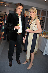 Mark Macaulay and COUNTESS ALEXANDER OF TUNIS at a party to celebrate the launch of Bentley's The Collection held at 6 Square Rigger Row, Plantation Wharf, York Road, London SW11 on 25th June 2012.