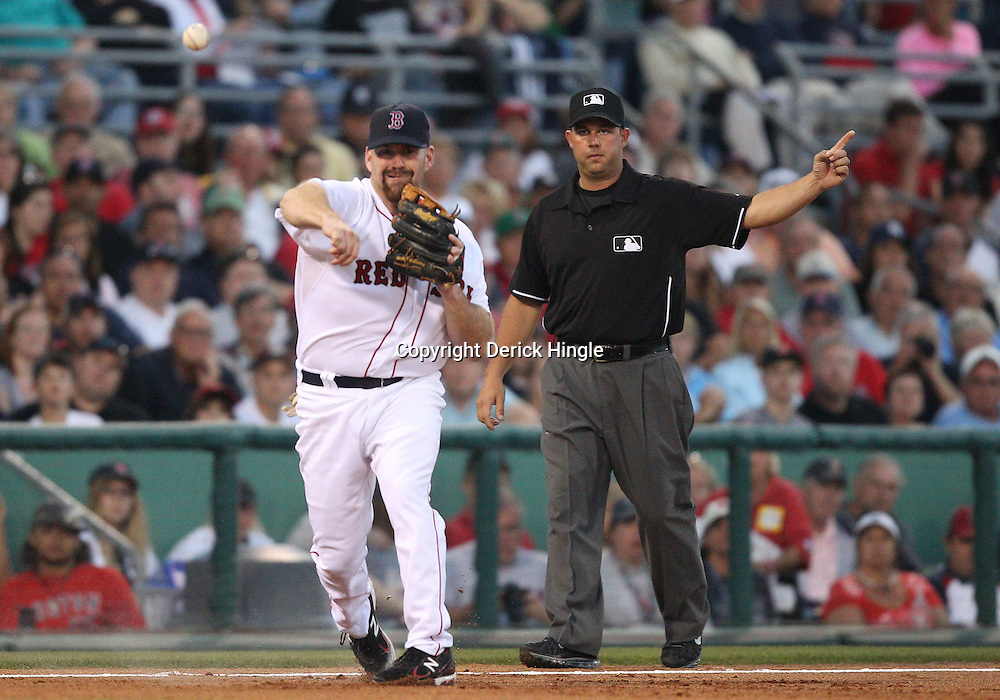 March 14, 2011; Fort Myers, FL, USA; Boston Red Sox third baseman Kevin Youkilis (20) during a spring training exhibition game against the New York Yankees at City of Palms Park.   Mandatory Credit: Derick E. Hingle