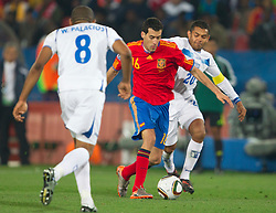 Sergio Busquets of Spain and Amado Guevara of Honduras during the 2010 FIFA World Cup South Africa Group H Second Round match between Spain and Honduras on June 21, 2010 at Ellis Park Stadium, Johannesburg, South Africa.  Spain defeated Honduras 2-0. (Photo by Vid Ponikvar / Sportida)