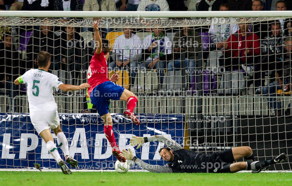 Bostjan Cesar of Slovenia, Marko Pantelic of Serbia and Samir Handanovic, goalkeeper of Slovenia shot during football match between National Teams of Slovenia and Serbia of UEFA Euro 2012 Qualifying Round in Group C on October 11, 2011, in Stadium Ljudski vrt, Maribor, Slovenia.  Slovenia defeated Serbia 1-0. (Photo by Vid Ponikvar / Sportida)
