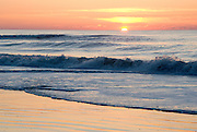Sunrise over the Atlantic Ocean at Chincoteague Beach, the ocean and the sky were in harmony and alive this morning.  I used a fast shutter speed to stop the waves and catch the light on the crest