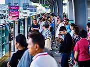 06 DECEMBER 2018 - SAMUT PRAKAN, THAILAND:  Passengers in Samrong station wait for a BTS Skytrain on the extension into Samut Prakan. The 12.6 kilometer (7.8 miles) east extension of the Sukhumvit Line of the Bangkok BTS Skytrain goes into Samut Prakan, a town east of Bangkok.  The system is now 51 kilometers long (32 miles), including the 12.6 kilometer extension that opened December 06. About 900,000 people per day use the BTS.      PHOTO BY JACK KURTZ