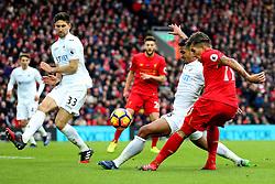 Roberto Firmino of Liverpool crosses - Mandatory by-line: Matt McNulty/JMP - 21/01/2017 - FOOTBALL - Anfield - Liverpool, England - Liverpool v Swansea City - Premier League
