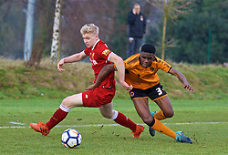WOLVERHAMPTON, ENGLAND - Tuesday, December 19, 2017: Liverpool's substitute Luis Longstaff and Wolverhampton Wanderer's Kevin Berkoe during an Under-18 FA Premier League match between Wolverhampton Wanderers and Liverpool FC at the Sir Jack Hayward Training Ground. (Pic by David Rawcliffe/Propaganda)
