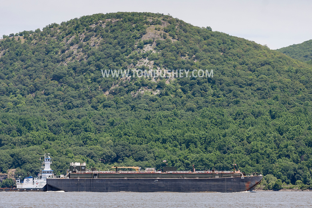 Cornwall-on-Hudson, New York - A tugboat pushes a barge south on the Hudson River in a view from Cornwall Landing on June 20, 2014. ©Tom Bushey / The Image Works