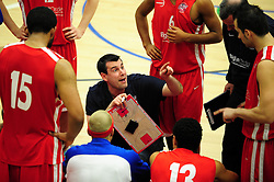 Bristol Academy Flyers' head coach, Andreas Kapoulas explains tactics at the end of the third quarter - Photo mandatory by-line: Dougie Allward/JMP - Tel: Mobile: 07966 386802 23/03/2013 - SPORT - Basketball - WISE Basketball Arena - SGS College - Bristol -  Bristol Academy Flyers V Essex Leopards