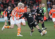 Blackpool - Saturday March 7th, 2009: Shaun Barker of Blackpool and Wes Hoolahan of Norwich City in action during the Coca Cola Championship match at Bloomfield Road, Blackpool. (Pic by Michael Sedgwick/Focus Images)