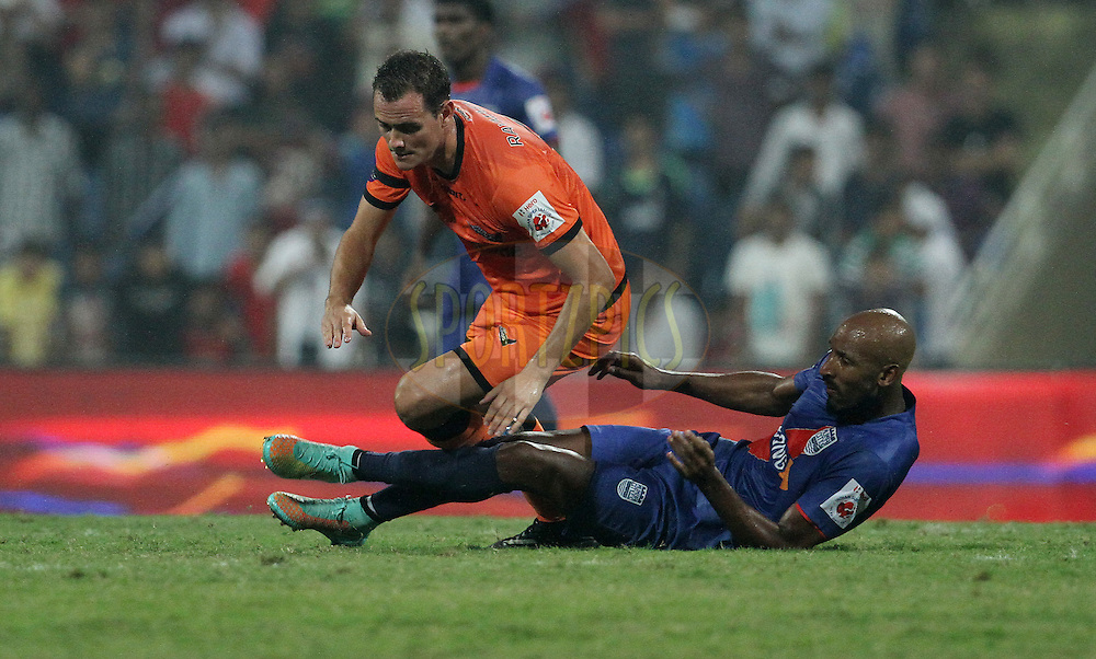 Nicolas Anelka of Mumbai City FC collides with Wim Raymaekers of Delhi Dynamos FC during match 22 of the Hero Indian Super League between Mumbai City FC and Delhi Dynamos FC City held at the D.Y. Patil Stadium, Navi Mumbai, India on the 5th November.<br /> <br /> Photo by:  Vipin Pawar/ ISL/ SPORTZPICS