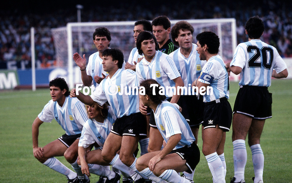 FIFA World Cup - Italia 1990<br /> 3.7.1990, Stadio San Paolo, Naples, Italy.<br /> Semifinal: Italy v Argentina.<br /> Argentina starting XI have posed for the team photo. From left Jorge Burruchaga, Claudio Caniggia, Ricardo Giusti, Julio Olarticoechea, Jos&eacute; Serrizuela, Jos&eacute; basulado, Gabriel Calderon, Sergio Goycochea, Oscar Ruggeri, Diego Maradona &amp; Juan Simon.