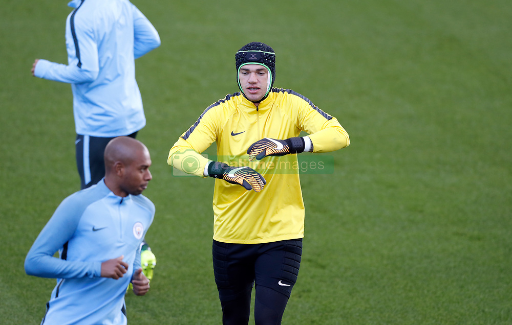Manchester City goalkeeper Ederson wears a protective helmet during the training session at the City Football Academy, Manchester.