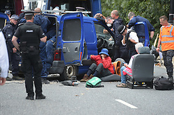 © Licensed to London News Pictures. 04/09/2019. London UK: Police officers deal with protestors close to the Excel centre on Wednesday after they concreted themselves into the side of a van in the Royal Docks road, east London, in protest at the up and comming arms fair, Photo credit: Steve Poston/LNP