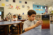 WARMINSTER, PA - SEPTEMBER 3: Braden Hill, 8 reads a book in the library on the first day of school September 3, 2013 at the new McDonald Elementary School in Warminster, Pennsylvania. (Photo by William Thomas Cain/Freelance)