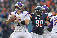 25 November 2012: Quarterback (7) Christian Ponder of the Minnesota Vikings passes the ball while being chased by (90) Julius Peppers of the Chicago Bears during the second half of the Bears 28-10 victory over the Vikings in an NFL football game at Soldier Field in Chicago, IL.