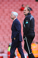 Alan Pardew , Manager of Newcastle United (left) with goal keeping coach Andy Woodman.  Pardew can return to the dug out following a 7 match touchline ban, before the Barclays Premier League match at the Emirates Stadium, London<br />