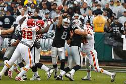 November 7, 2010; Oakland, CA, USA;  Kansas City Chiefs linebacker Derrick Johnson (56) deflects a pass from Oakland Raiders quarterback Jason Campbell (8) during the first quarter at Oakland-Alameda County Coliseum.