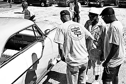 Members of the Felton St Cruisers of West Philadelphia talk to Jerome Adams, 69, of North Philadelphia who just rolled up in a classic car that always has belongs to his family, during a car meet up in North Philadelphia, on September 15, 2019.